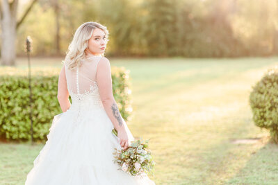A photo of a bride at sunset for her wedding at Englund Estate in Cuthbert Georgia by Jennifer Marie Studios.
