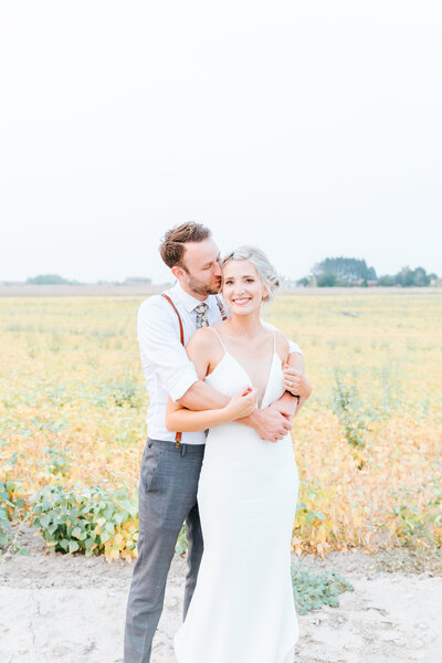Couple in Field at Romantic Deer Flat Ranch Wedding