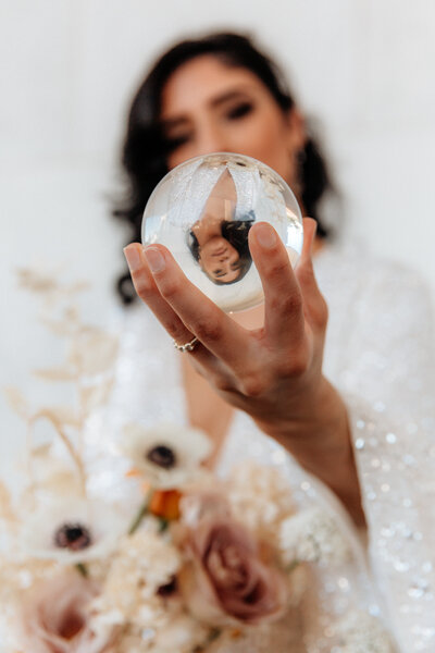 bride holding glass ball