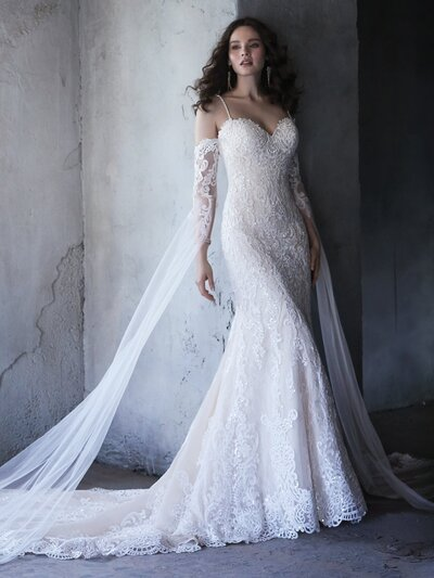 Fit-and-Flare Wedding Dress. Be true to the classics, but embrace the details. This romantic fit-and-flare wedding dress features a timeless silhouette, while delicate spaghetti straps and delicate lace train add the perfect dose of ooh-la-la.