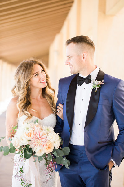 Bride with blush bouquet and groom in blue tux