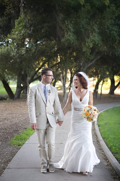 Bride and Groom walking at their wedding at Temecula Creek Inn