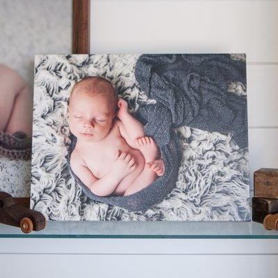 newborn session canvas wrap displayed in studio