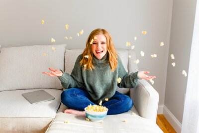 Wedding photographer Samantha Grant tossing popcorn in the air at brand shoot
