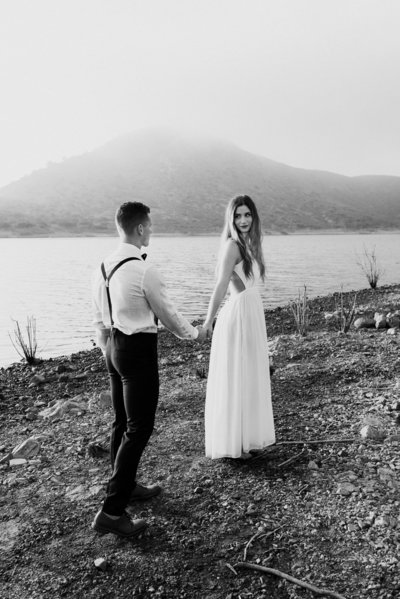 adventurous couple walking along a lake in Colorado on their elopement