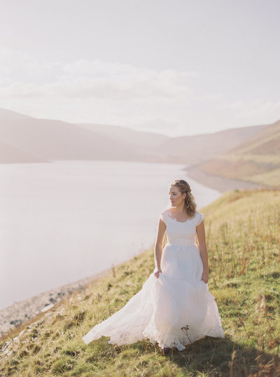 Scotland Bride Walking Through Scottish Highlands in the Fall