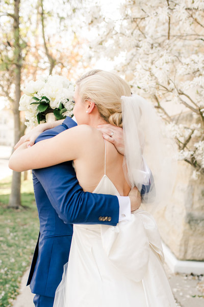 Close up of bride and groom hugging right after their wedding ceremony outside of the church in Ohio