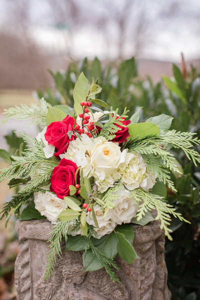 evergreen and roses wedding bouquet at the Golden Horseshoe Inn wedding venue
