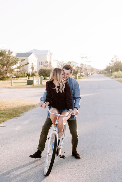 man and woman riding on bicycle together