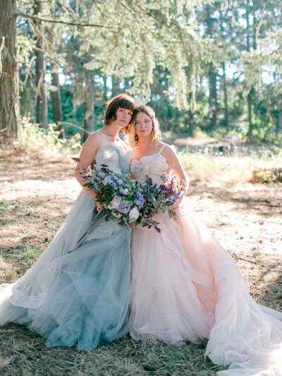 pastel bridesmaids in field