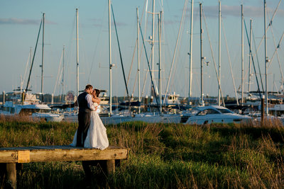 bride and groom on docks at the historic rice mill