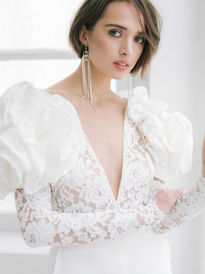 WHAM Rime Arodaky bridal couture wedding jumpsuit with edgy white big puffy shoulders 07