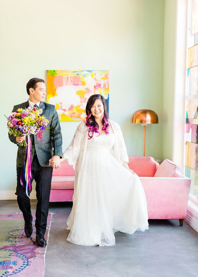 Bride and groom walking at their Fig House Wedding In Los Angeles, California. Wedding photo taken by Cheers Babe Photo.