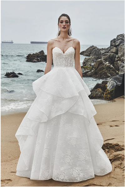 Ivory lace Ball gown silhouette Off-the-shoulder neckline Sweetheart neckline Classic tiered skirt Cascading train