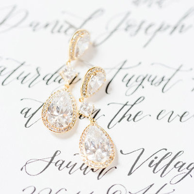bridal-earrings-on-calligraphy-script-of-the-invitations
