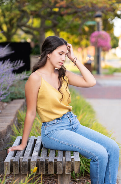 girl in yellow shirt on a bench