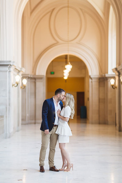 sweet wedding couple kissing on 4th floor sf city hall