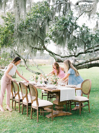 Samantha Anderson Events Team - Samantha Anderson and Sarah Rickman setting Wedding Tablescape at Middleton Place