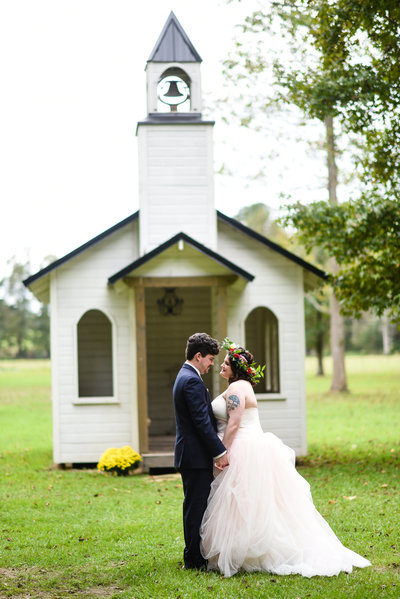 Couple in front of tiny chapel, The Hideaway in Brookhaven, MS, MIssissippi Wedding