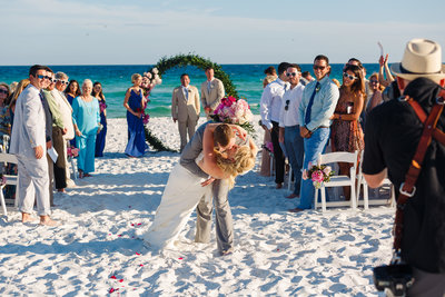 Groom and Bride Kiss at the End of their Destin Florida Destination Wedding Ceremony