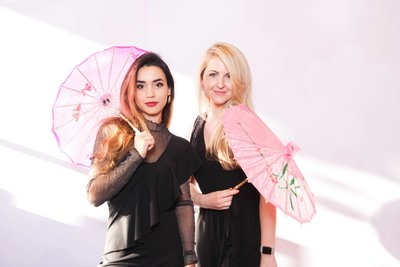 philly snap booth team posing with two japanesse umbrellas