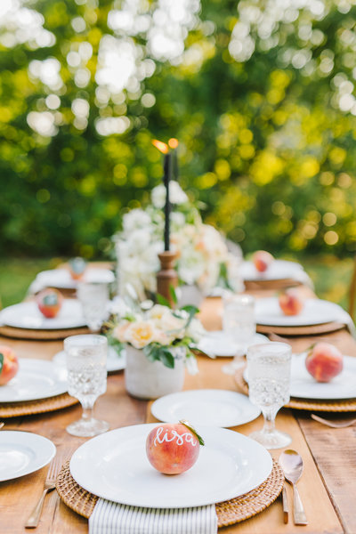 table setting with white plates & peaches