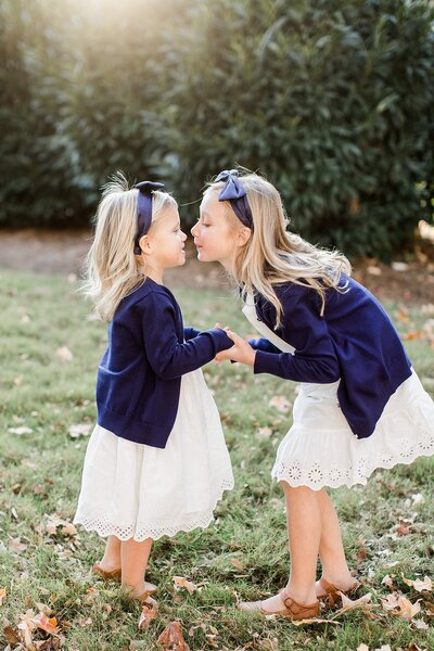 sisters in matching outfits by Knoxville Wedding Photographer, Amanda May Photos