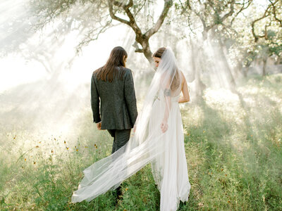 boho bride and groom in forest