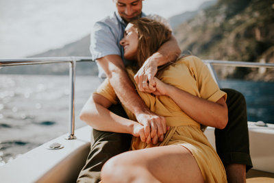 couple cuddling on boat