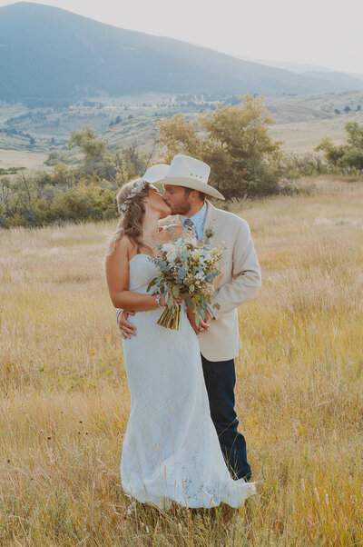Couple kisses during wedding at Eatons Ranch