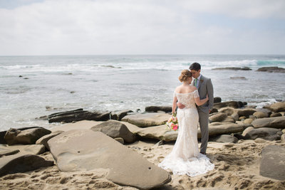 Bride and Groom on cliffs near ocean at La Jolla Women's Club