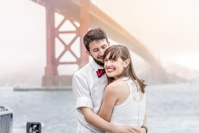 Dressed up couple in front of Golden Gate Bridge in the San Francisco Bay Area, taken by Bay Area photographer