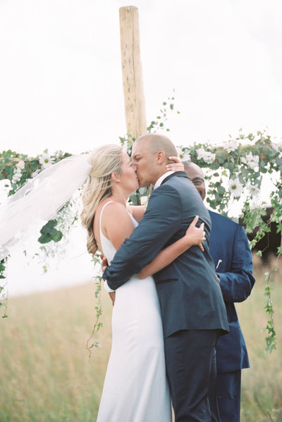First Kiss as Husband and Wife at Montana Wedding