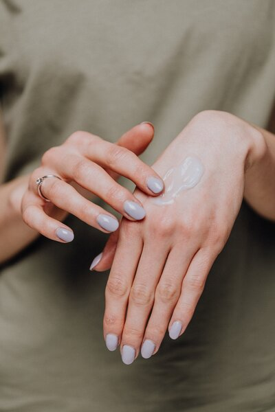 woman's hands applying Bloom Box product