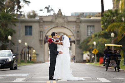 Bride and Groom standing in street before their wedding at St Francis Chapel at Balboa Park