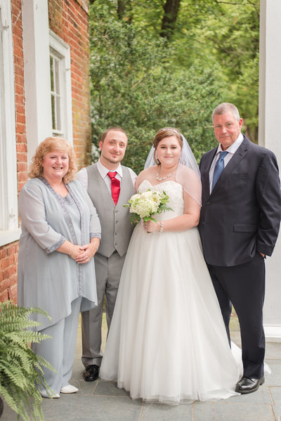 happy family on the front porch of the all inclusive wedding venue