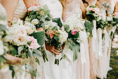 Line of Bridesmaids holding bouquets of flowers in Buffalo, New York