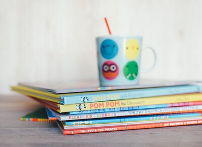 picture books and coffee mug