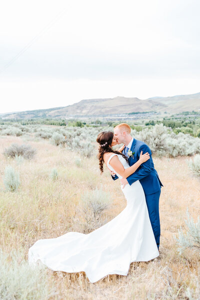 Bride and Groom Kissing in the Boise Foothills