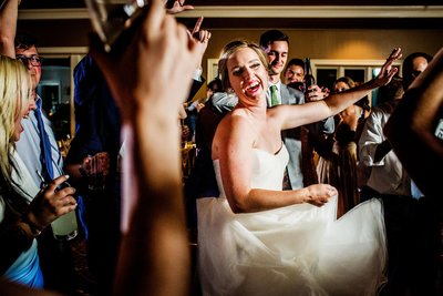 A bride dances along with her guests during a Chicago wedding.