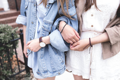 Two Girls Arm in Arm