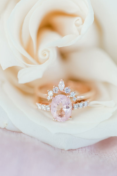 A close-up photo of a  pink diamond inside of a flower