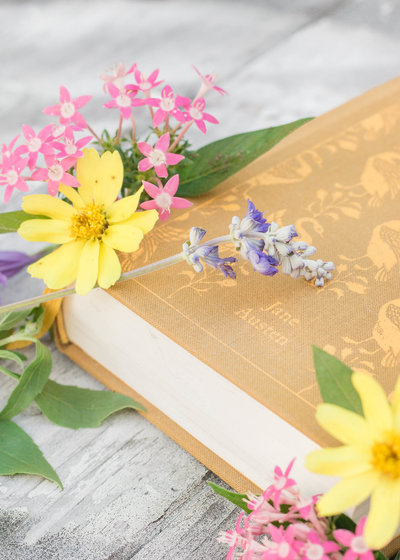 jane austen book surrounded by wildflowers