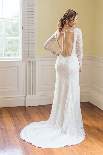 Back view of the Hudson wedding dress's low open back from the Classics bridal collection