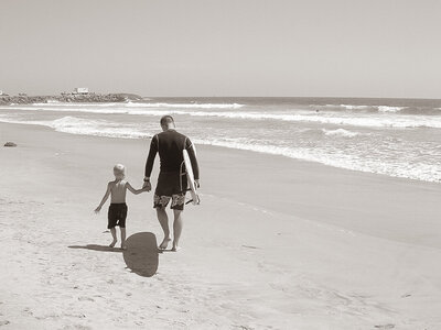 surfing father and son
