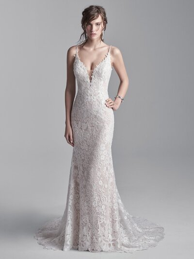 Floral Lace Sheath Bridal Gown. Abundant florals are the key to this sexy lace V-back sheath bridal gown's chic and boho charm. We're giving A+ in shimmer, wearability, and presentation.