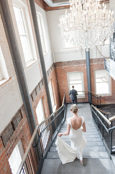 Bride and Groom First Look on Grand Staircase at the JX Venue in Stillwater