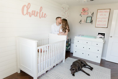new-parents-kiss-in-light-neutral-Gaithersburg-Maryland-home