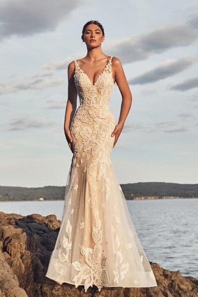 Beaded lace Mermaid silhouette V-neckline Bold floral motifs Extra bodice construction Cascading tulle train