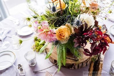 Wedding floral table centerpiece  with natural style at Onteora Mountain House in the Hudson Valley. Catskills wedding florist